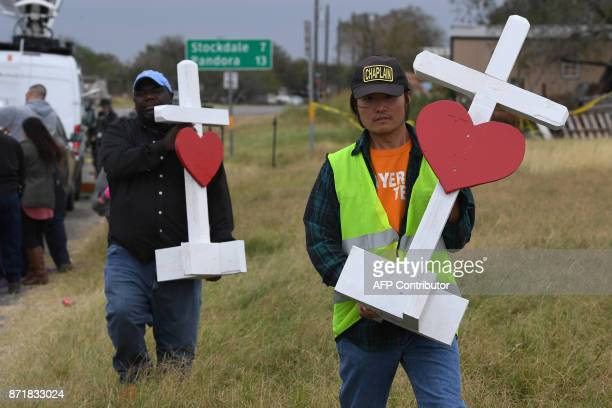 Chaplain Tom Kiyuna helps unload crosses outside the First Baptist Church which was the scene of the mass shooting that killed 26 people in...