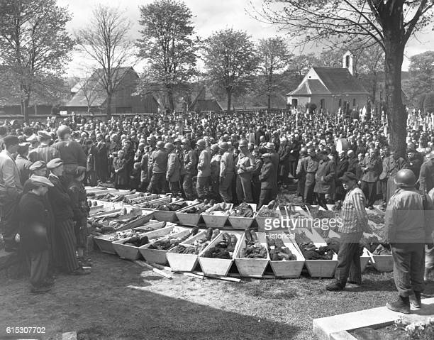 Chaplains of the US Third Army conduct burial services for the 120 Russian and Polish Jews victims of SS troopers in a wood near Neunburg Germany...