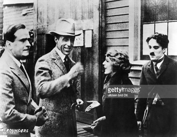 Chaplin Charlie Actor film director Great Britain with the founders of 'United Artists' Douglas Fairbanks sen DW Griffith and Mary Pickford undated...