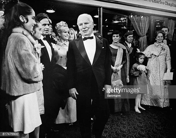 Chaplins at Premiere. London: Charlie Chaplin is accompanied by the women in his family at the premiere of his first movie in ten years, A Countess...