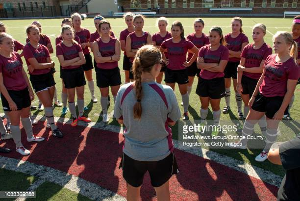 Chapman University head women's soccer coach Courtney Calderon center gives a prepractice talk to the team INFORMATION chadmissions0916 Ð 9/10/14 Ð...