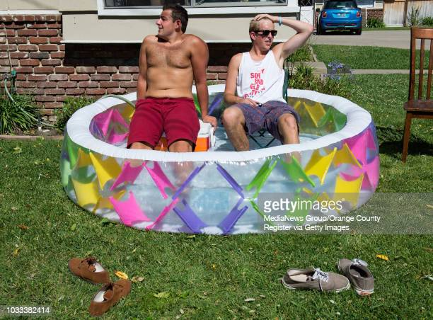 Chapman University students Connor Satterfield left and Connor Caproni both 20 use a child's pool they ordered online to cool off after temperatures...