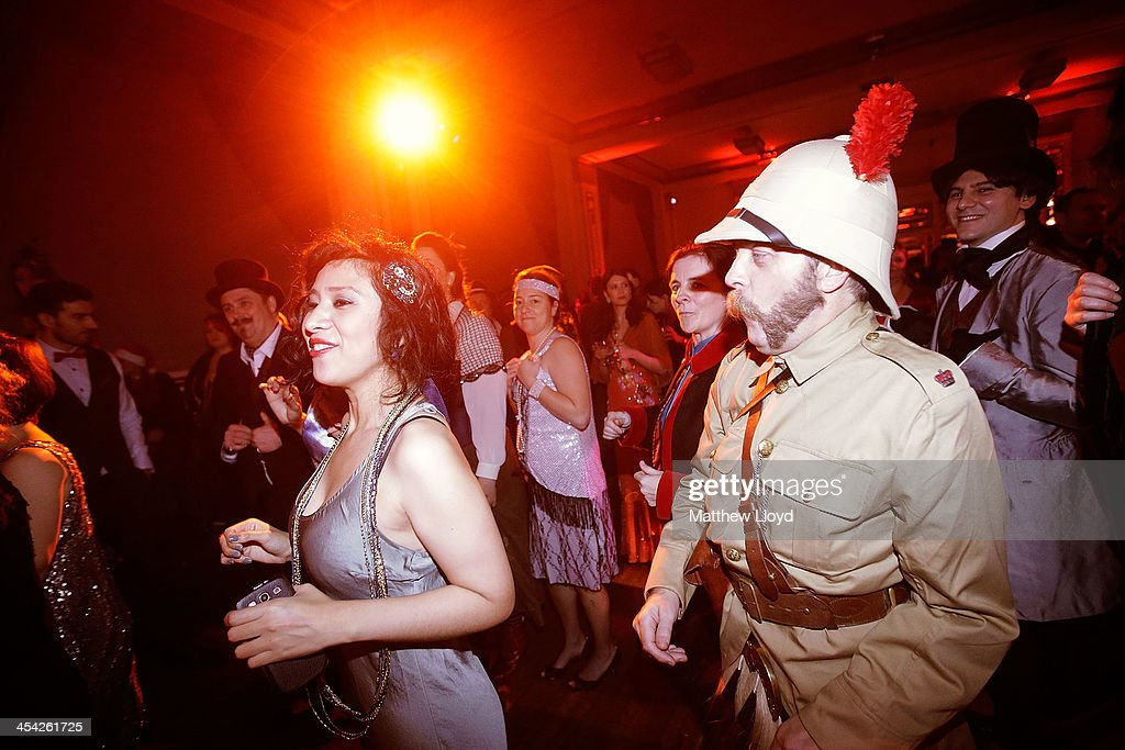 'Chaps and Chapettes' practice the steps to a dance at the Fifth Grand Anarcho-Dandyist Ball at the Bloomsbury Ballroom on December 7, 2013 in London, England. The Ball is a celebration of traditional English attire, etiquette and eccentricity, featuring acts such as Sir Henry at Rawlinson End, Vivian Stanshall's rambling, surreal, whimsical musical tribute to the decaying English aristocracy and learning the Lambeth Walk vintage dance step, accompanied by vintage cocktails and swing music.