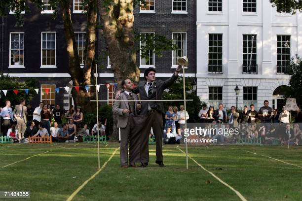 Chaps prepare themselves for the three legged limbo competition in a pair of altered vintage trousers on July 13 2006 in London England The Chap...