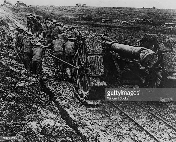 Chapter 4F British troops struggle in the mud to move this 6 howitzer up to the front in the Somme Ancre area Sept 1916 British Front France 1916...