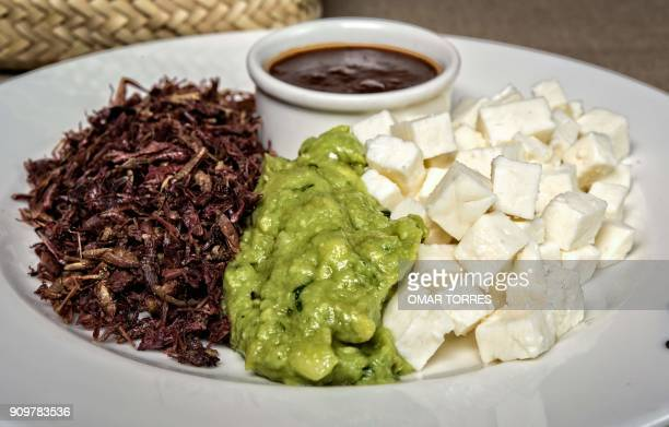 Chapulines guacamole Oaxaca cheese and chili sauce are ingredients for a special taco created by chef Alejandro Pinon at Los Danzantes restaurant in...