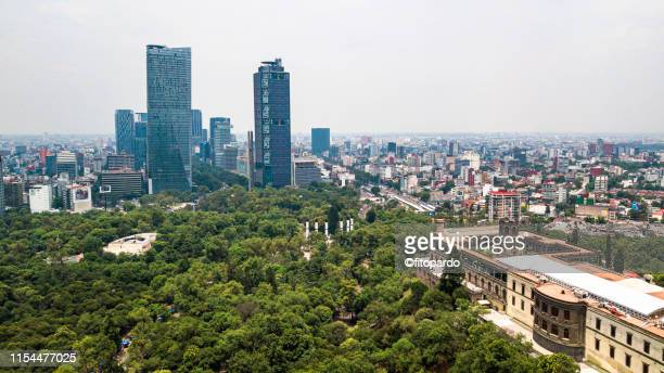 chapultepec castle and modern skyscrapers in the horizon - chapultepec park stock photos and pictures