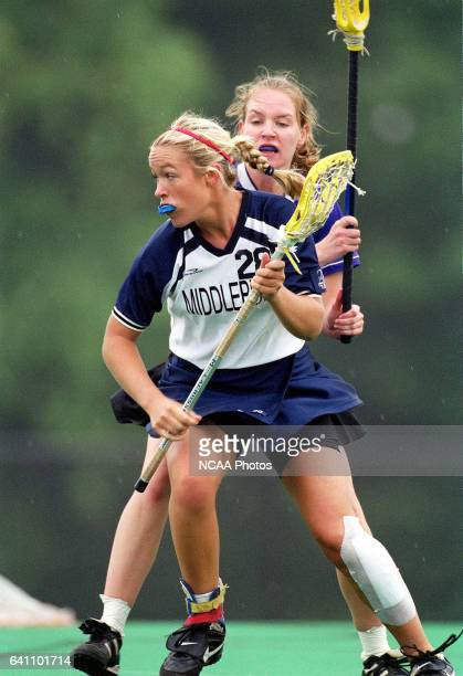 Char Glessner of Middlebury College maneuvers around Abigail Ouimet of Amherst College during the Division 3 Women's Lacrosse Championship held at...