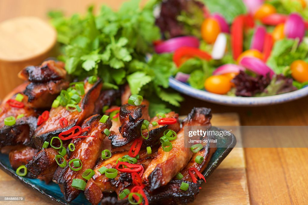 Char Siu Chicken Wings W Salad High-Res Stock Photo - Getty
