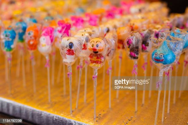 Character candy seen sold during the Iwakura Cherry Blossom Festival The highlight of the festival is long line of trees created by around 1400...