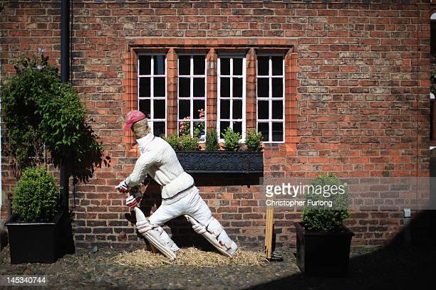 A character scarecrow of a cricketer adorns the outside of a cottage in the English village of Great Budworth in preparation for next week's Diamond...