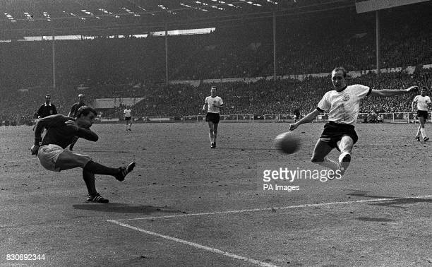 Characteristically puffing out his cheeks Geoff Hurst lashes the ball past Willi Schulz to score England's third goal in extra time of the World Cup...