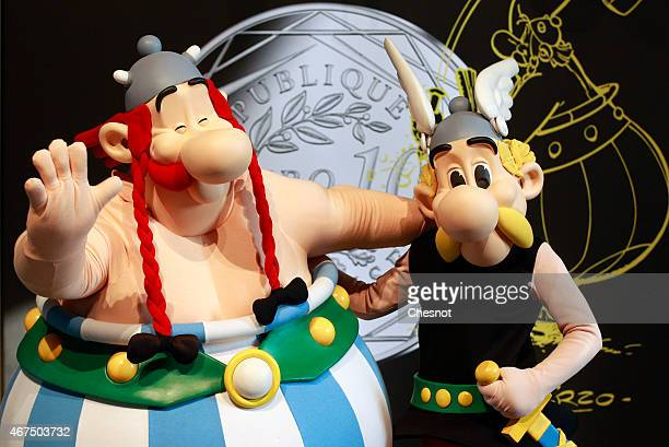 Characters Asterix and Obelix pose after a press conference at the Monnaie de Paris on March 25 in Paris France A new twelve piece coin series...