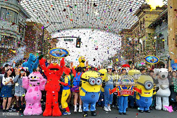 Characters at Universal Studios Japan celebrate the park's annual attendance record with visitors at the theme park on March 7 2016 in Osaka Japan...