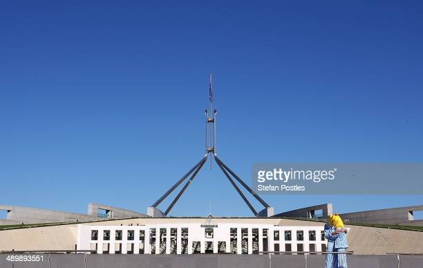 ABC characters Bananas in Pyjamas embrace prior to an ABC protest rally outside of Parliament House on May 13 2014 in Canberra Australia Tony...