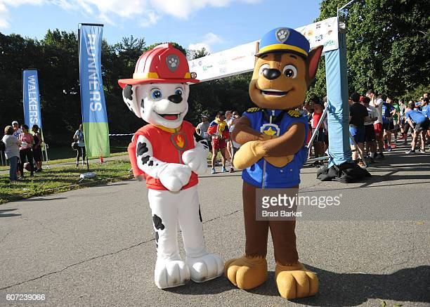 Characters Chase and Marshall of Paw Patrol pose at the start of the 5k race of Nickelodeon's 13th Annual Worldwide Day Of Play at The Nethermead...