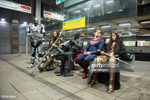 Characters Cyborg Aquaman Batman Superman and Wonder Woman from the Justice League film pose in character at the end of a photocall accross London...