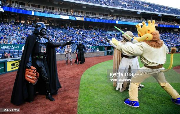 Characters dressed as Darth Vader Luke Skywalker and Sluggerrr do the force choke pose before the game between the Detroit Tigers and the Kansas City...