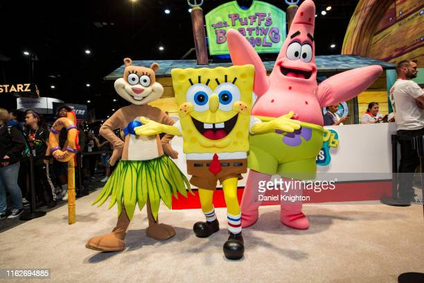 Characters from Sponge Bob Squarepants pose at the Nickelodeon booth at San Diego Convention Center on July 17, 2019 in San Diego, California.