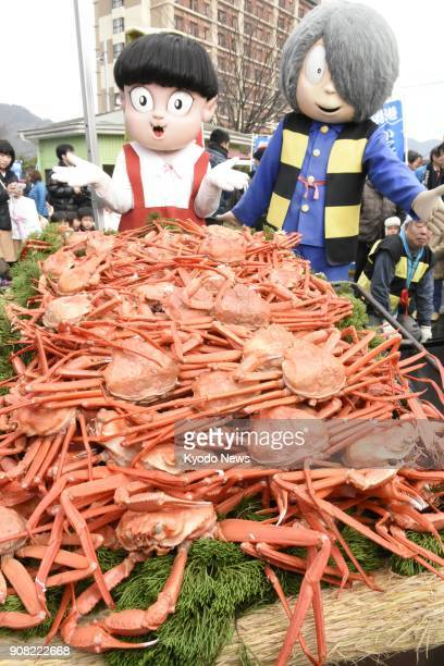 """Characters from the popular horror comic series """"Gegege no Kitaro"""" show off a pile of crabs on a cart during a ceremony of gratitude for crabs in..."""