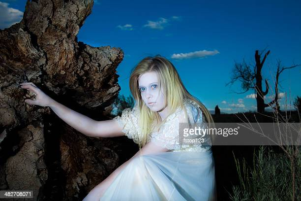 characters: haunting, sad ghost woman in forest.  victorian white dress. - dead girl stock pictures, royalty-free photos & images