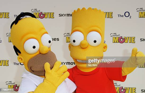 Characters Homer and Bart Simpson arrive at the Simpsons Premier at the O2 Vue cinema Greenwich on July 25 2007 in London England