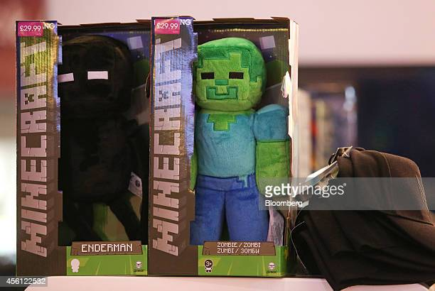 Characters including 'Enderman' and 'Zombie' from the game Minecraft produced by Mojang AB sit displayed for sale during the EGX gaming conference at...
