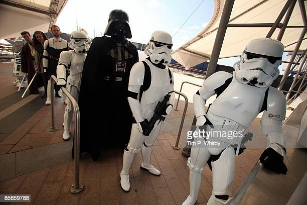 Characters including Stormtroopers Darth Vader and Jedi Knights from the Star Wars series of films queue at the ticket office at The O2 Arena ahead...