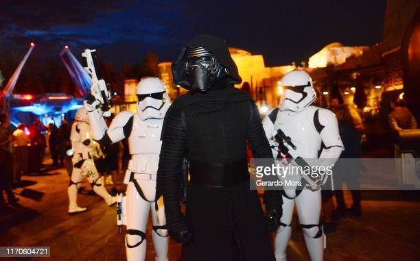 Characters Kylo Ren and Storm Troopers walk during night at the Star Wars: Galaxy's Edge Walt Disney World Resort Opening at Disney's Hollywood...