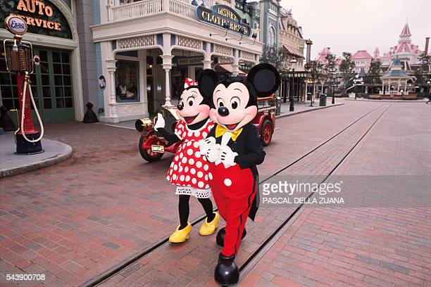 Characters Mickey and Minnie Mouse in the streets of Disneyland Paris Resort