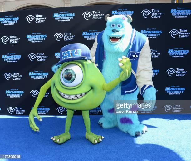 Characters Mike Wazowski and James Sullivan attends the premiere of Disney Pixar's Monsters University at the El Capitan Theatre on June 17 2013 in...