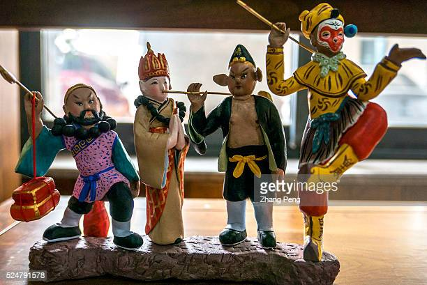 Characters of Journey to the West made in Huishan clay figurine technique Huishan clay figurines with a history of more than 400 years originated in...