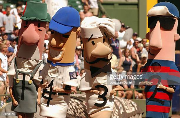 Characters walk on the field performing their routine during the interleague game between the Minnesota Twins and the Milwaukee Brewers on June 22...