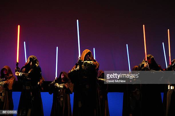 Characters wielding lightsabers take to the stage to promote Star Wars The Old Republic at the Entertainment Software Association press conference...