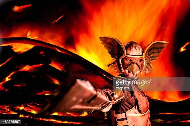 Characters: Winged warrior raises his sword. Explosive fire background.