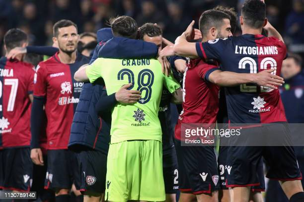 Charalambos Lykogiannis and Alessio Cragno of Cagliari celebrate victory at the end of during the Serie A match between Cagliari and ACF Fiorentina...