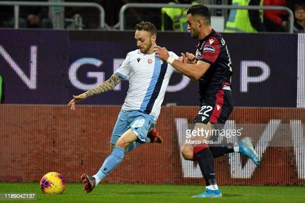 Charalampos Lykogiannis of Cagliari Calcio competes for the ball with Manuel Lazzari of SS lazio during the Serie A match between Cagliari Calcio and...