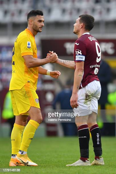 Charalampos Lykogiannis of Cagliari Calcio salutes Andrea Belotti of Torino FC at the end of the Serie A match between Torino FC and Cagliari Calcio...