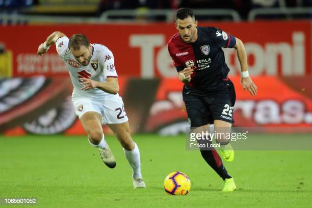 Charalampos Lykogiannis of Cagliari vies with Lorenzo de Silvestri of Torino during the Serie A match between Cagliari and Torino FC at Sardegna...