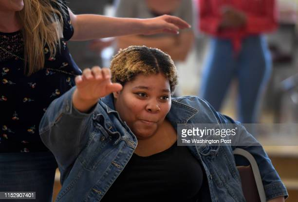 Charay Johnson claims a chair as foster children and volunteers played a game of musical chairs at the Nineteenth Street Baptist Church in...