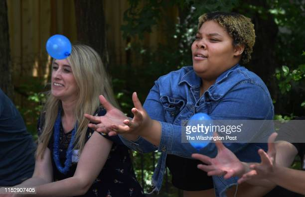 Charay Johnson participated in a balloon catch game at the Nineteenth Street Baptist Church in Washington, D.C. On June 22, 2019. At left is...