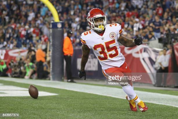 Charcandrick West of the Kansas City Chiefs celebrates scoring a touchdown during the fourth quarter against the New England Patriots at Gillette...
