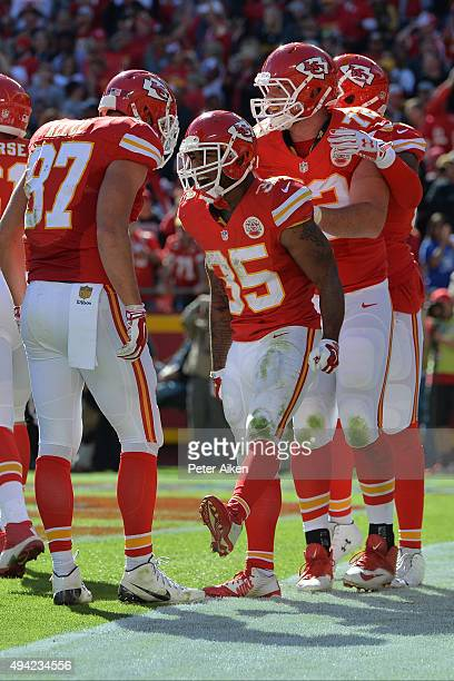 Charcandrick West of the Kansas City Chiefs celebrates with teammates Travis Kelce and Eric Fisher of the Kansas City Chiefs against the Pittsburgh...