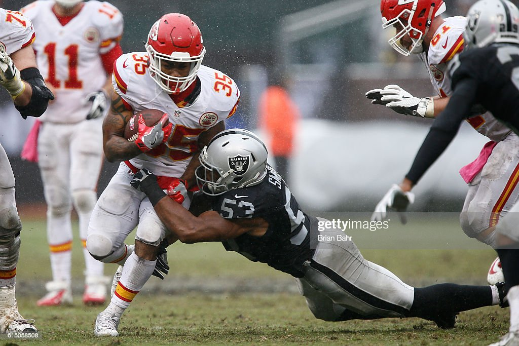 Charcandrick West #35 of the Kansas City Chiefs is tackled by Malcolm Smith #53 of the Oakland Raiders during their NFL game at Oakland-Alameda County Coliseum on October 16, 2016 in Oakland, California.