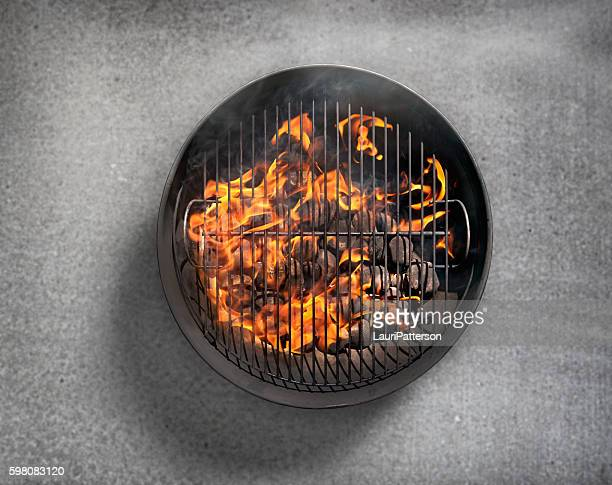 charcoal bbq on a concrete patio - directly above stock pictures, royalty-free photos & images