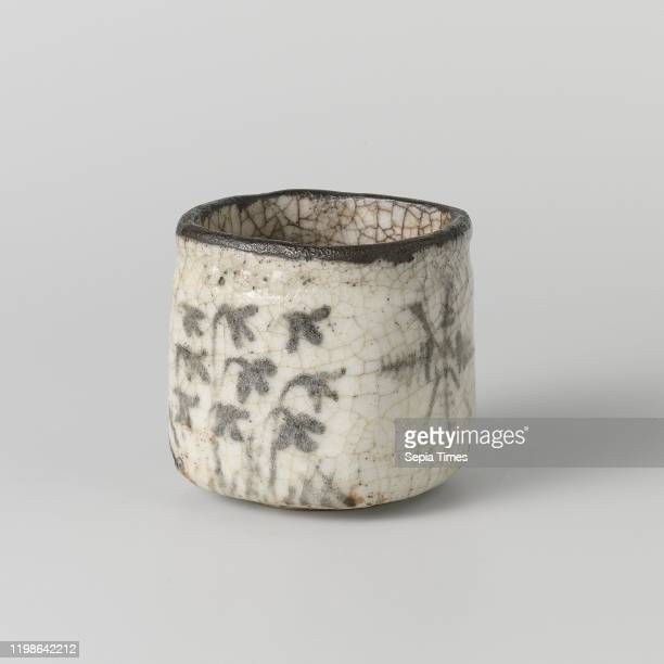 Charcoal burner with plants and a frame square charcoal burner of stoneware covered with a crackled creamcolored glaze and painted in underglaze...