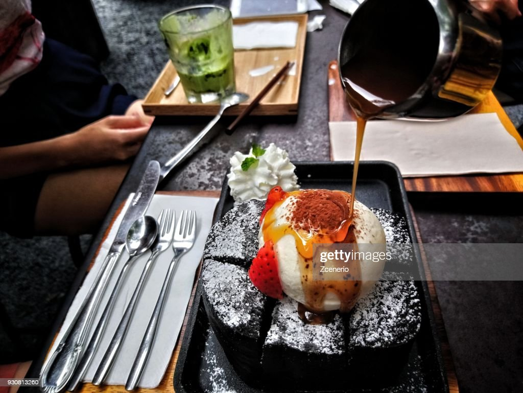 Charcoal honey toast with vanilla icecream and strawberry on top : Stock Photo