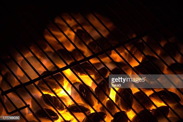 Charcoal on fire in a BBQ grill.