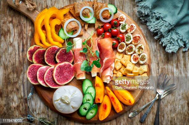 charcuterie and cheese platter served for party - charcuteria fotografías e imágenes de stock