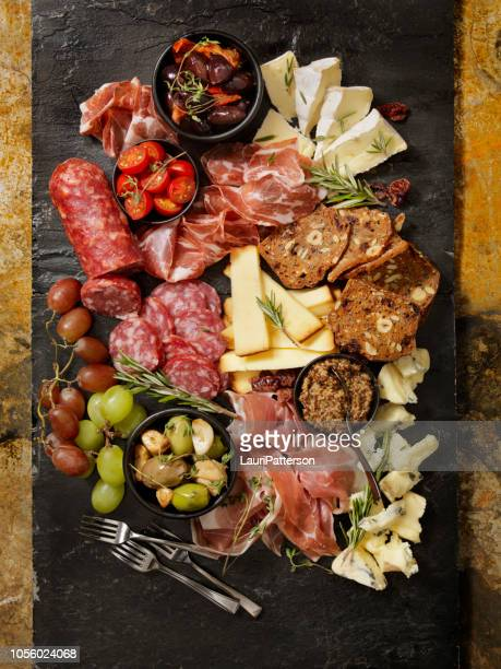 charcuterie board - delicatessen stock pictures, royalty-free photos & images
